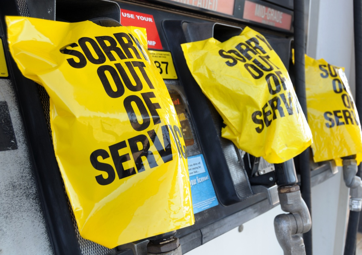 """Empty gas pump with """"Out of Service"""" notices."""