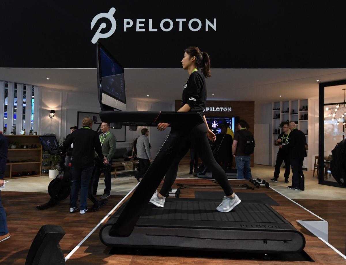 woman using peloton treadmill