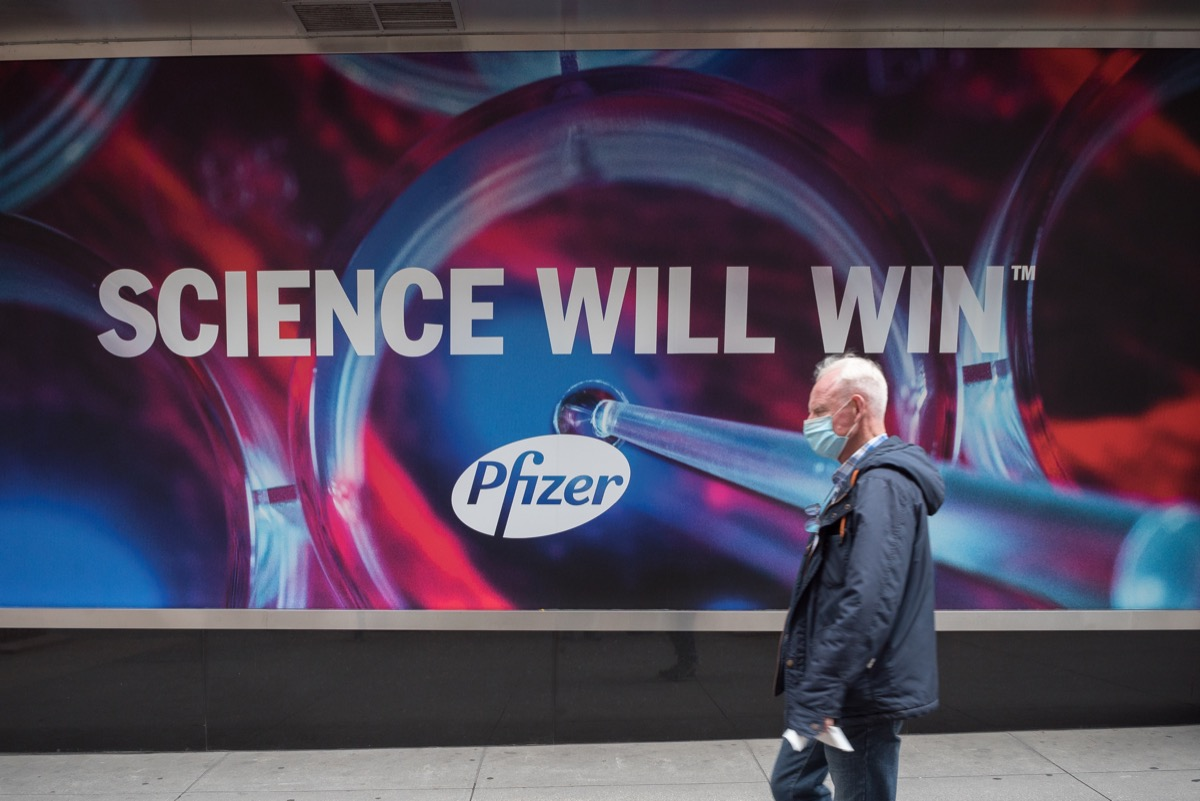 Manhattan, New York. November 27, 2020. A man walks in front of Pfizer headquarter in Midtown.