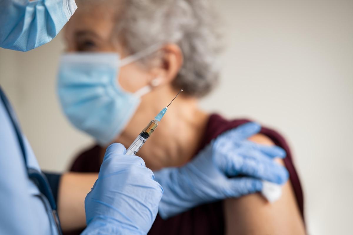 Older woman getting COVID vaccine