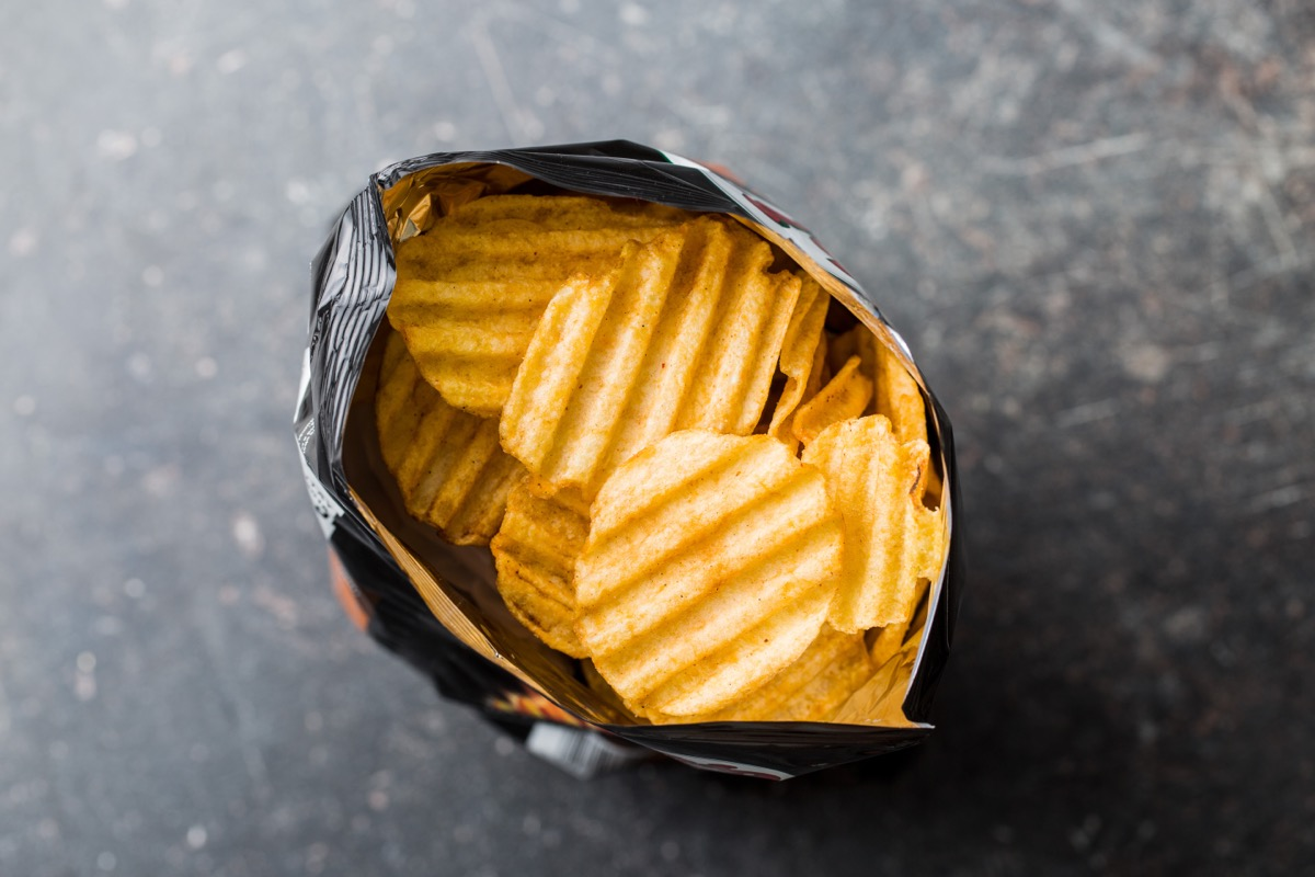 bag of open ruffled potato chips