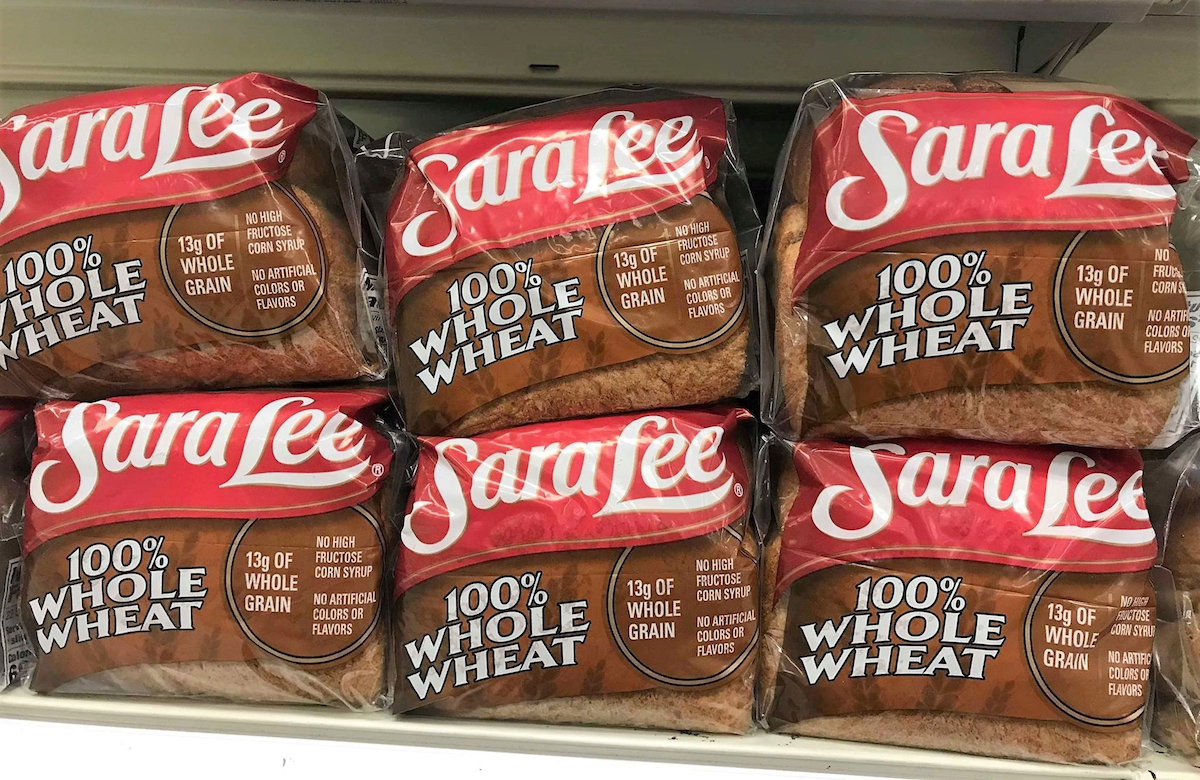 Classic 100% Whole Wheat Sara Lee Bread loaves in Supermarket