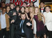 """Jack Black and fellow cast members attend the premiere of the movie """"School of Rock"""" at the Cinerama Dome September 24, 2003 in Hollywood, California."""