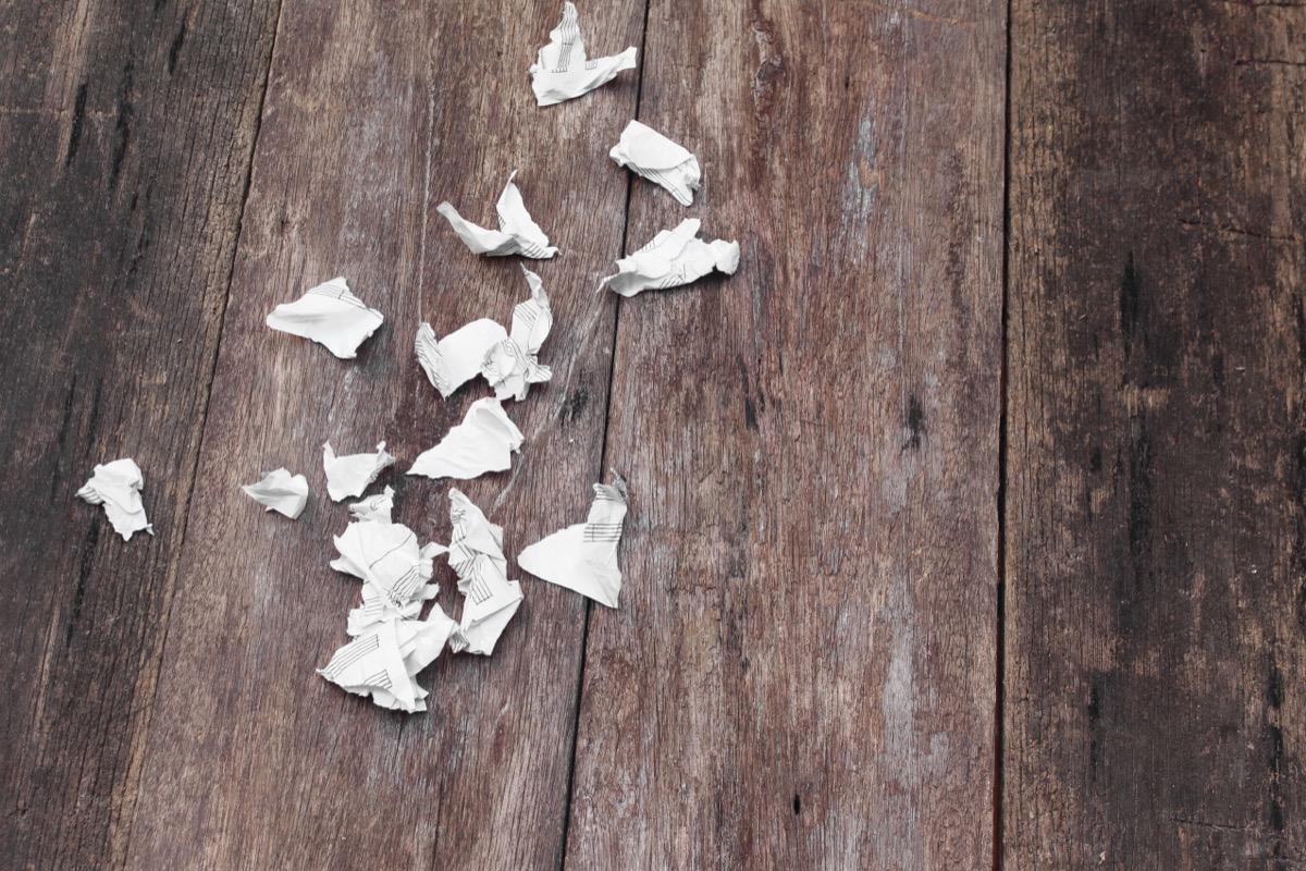 shredded paper on wooden floor