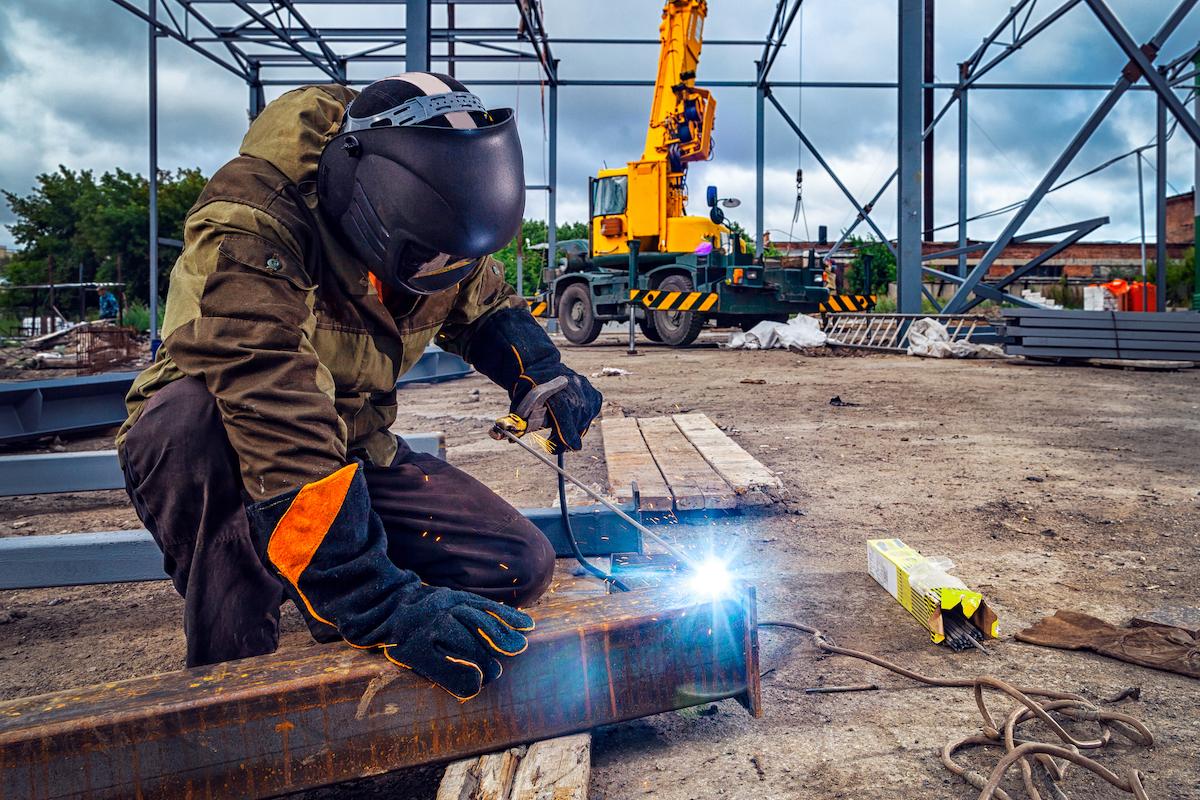 Steel worker welding