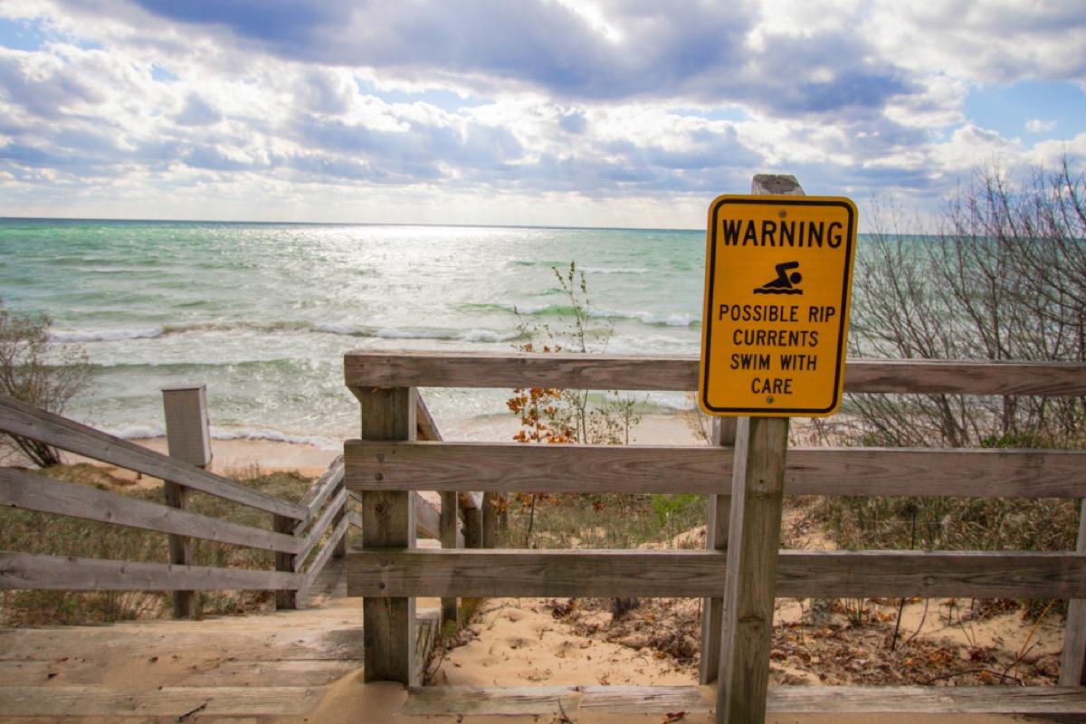 rip current warning sign near ocean
