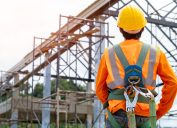 Construction worker in safety harness and hard hat