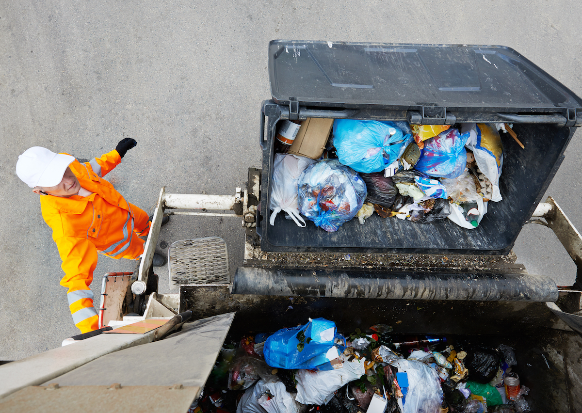 Garbage collector on garbage truck