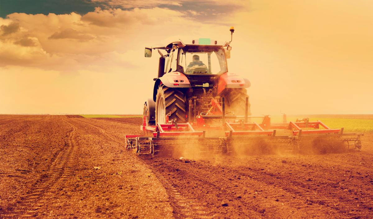Farmer plowing field in a tractor