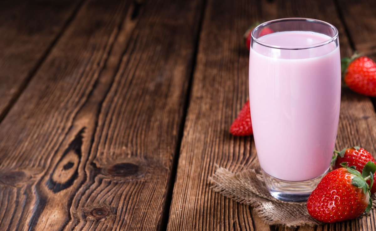 strawberry milk on wooden table