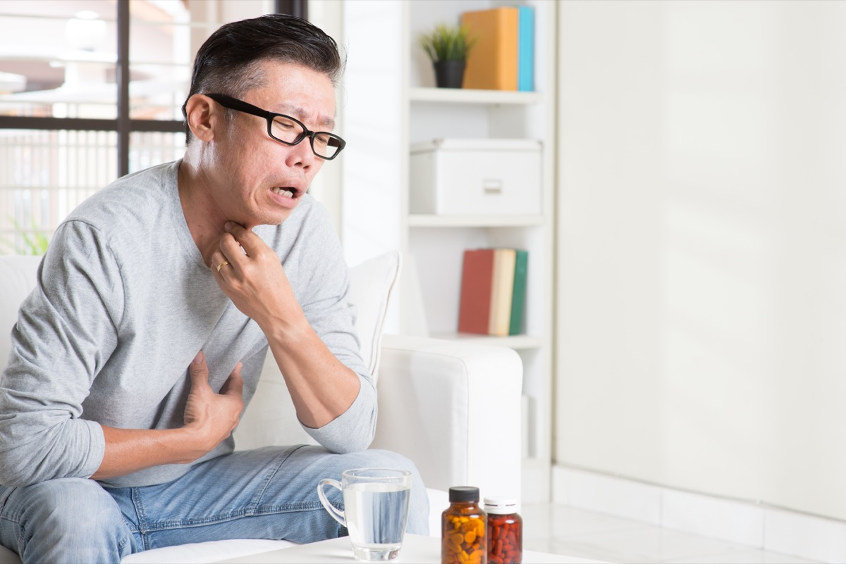 Older man struggling to swallow