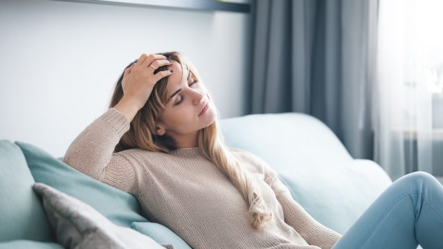 Woman with fatigue from long COVID illness
