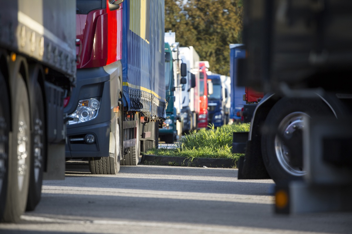 trucks stopped at a crowded rest area