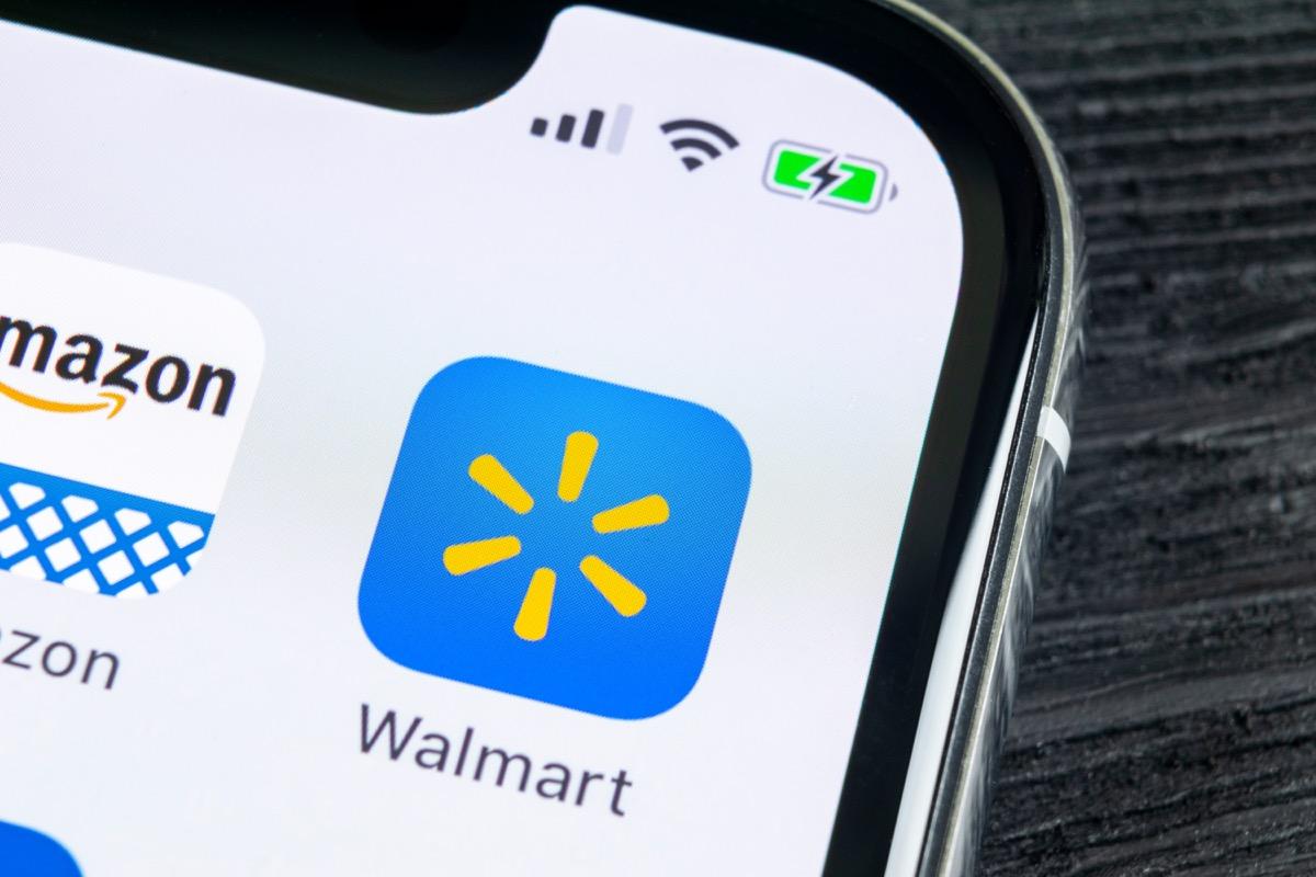 Sankt-Petersburg, Russia, April 27, 2018: Walmart application icon on Apple iPhone X screen close-up. Walmart app icon. Walmart.com is multinational retailing corporation