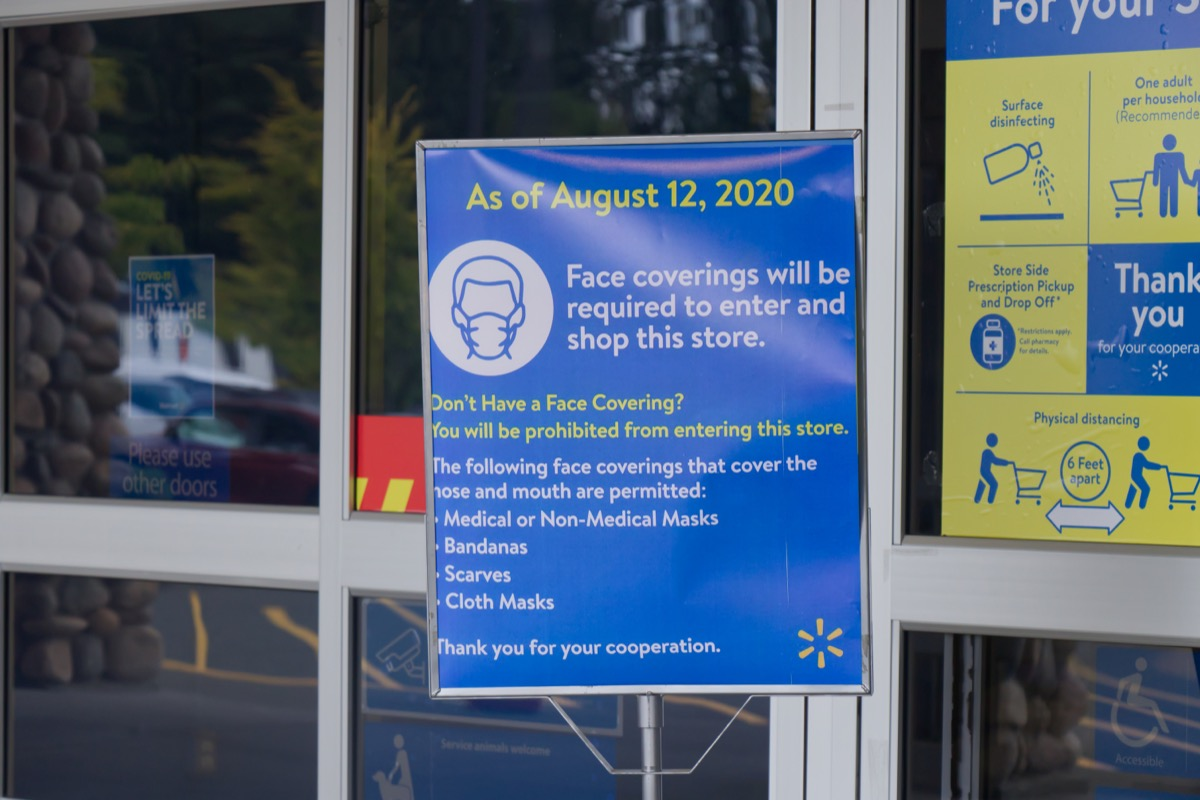 mask sign hanging in walmart store entry