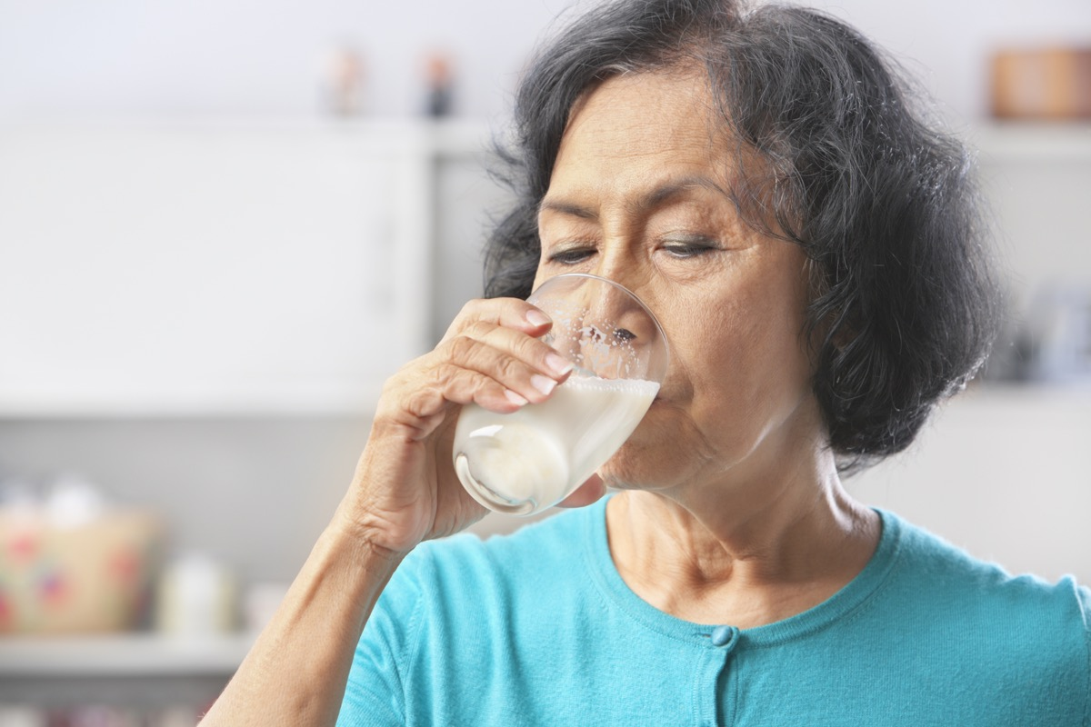 woman drinking milk at home