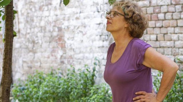 Woman looking at bugs in yard