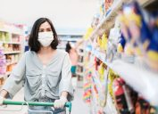 woman wearing mask, shopping for snacks