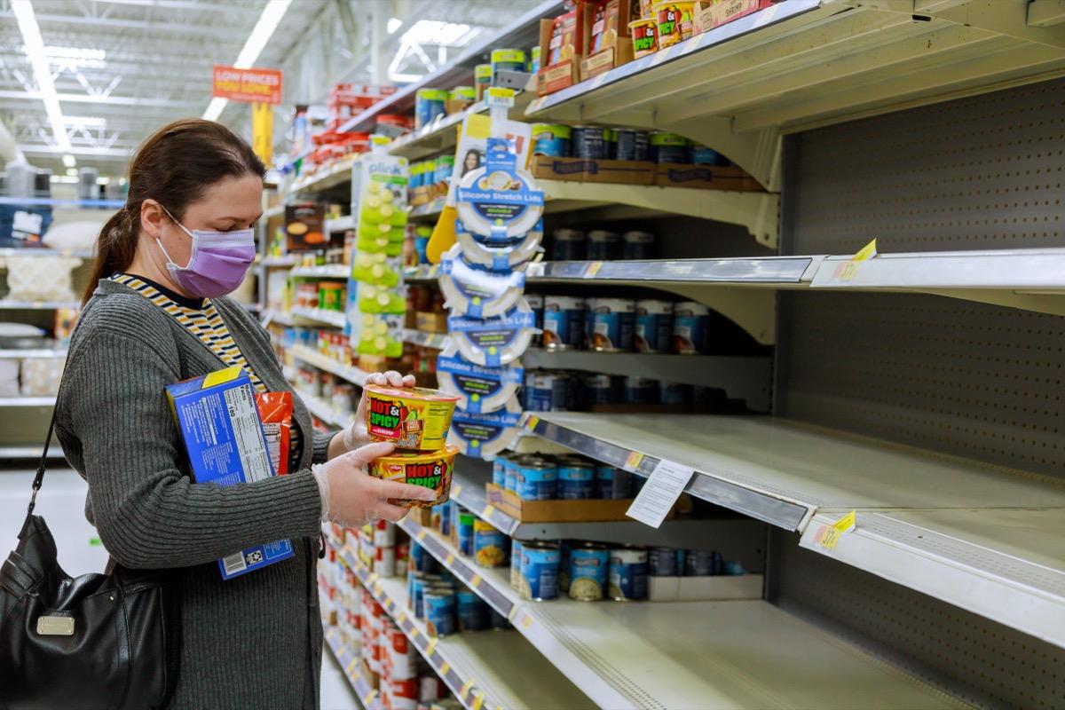 woman shopping at walmart amid covid pandemic