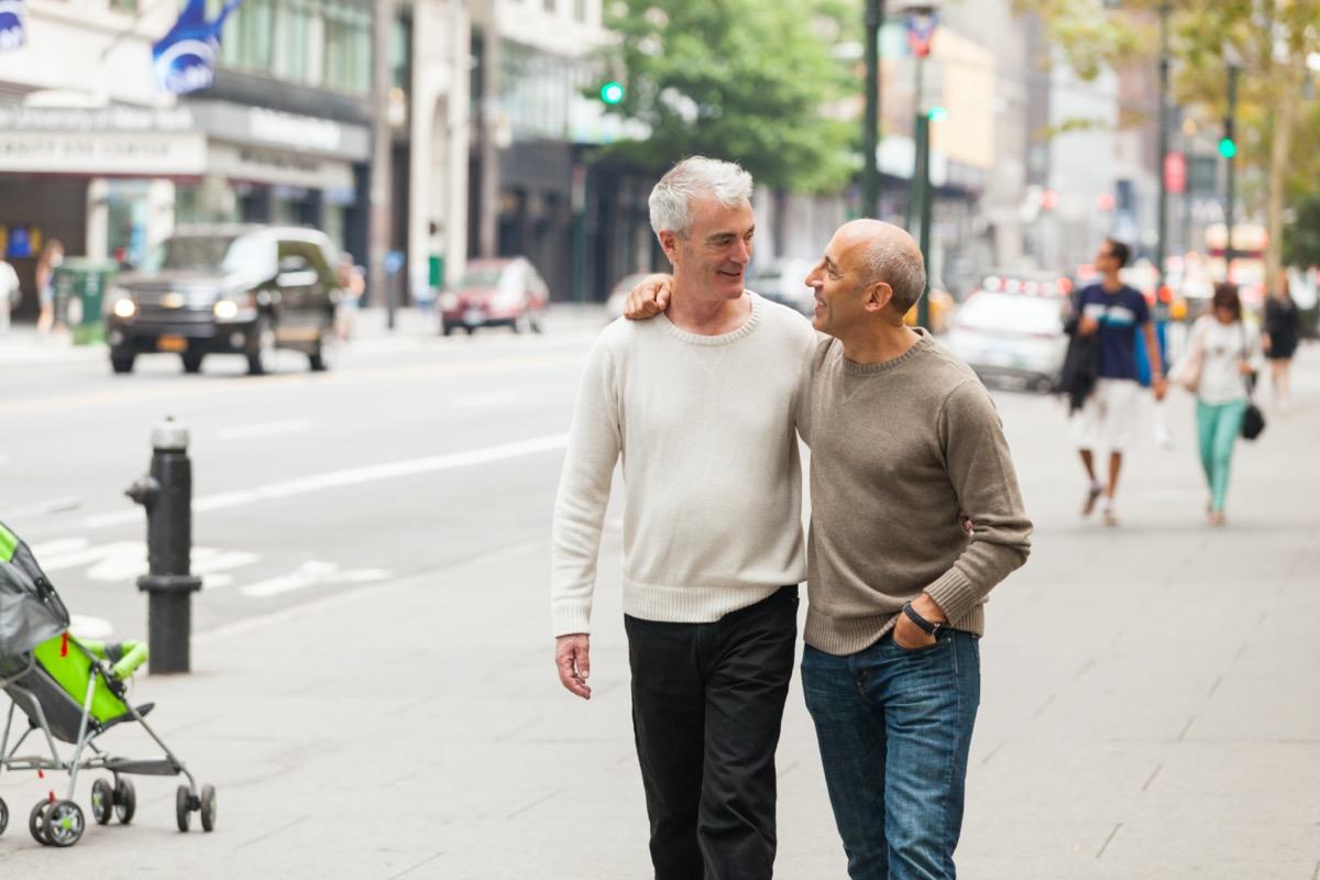 Two men on city walking date