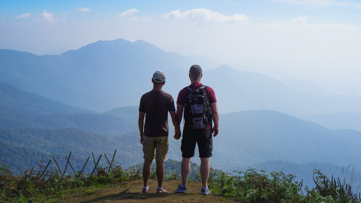 Couple standing at summit on hike