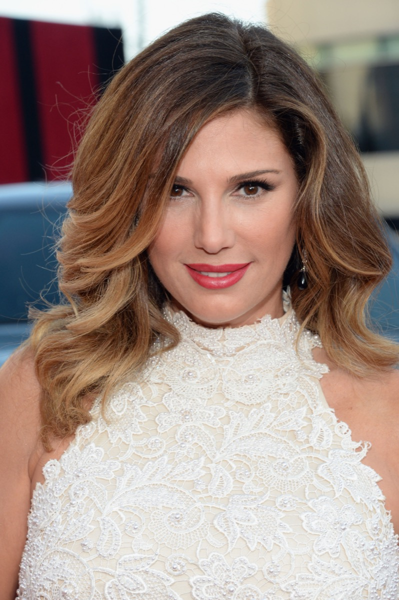 Daisy Fuentes wearing white lace top