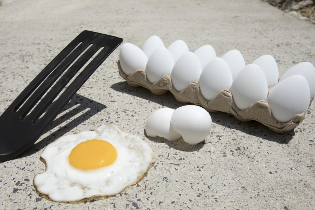 Frying egg on sidewalk