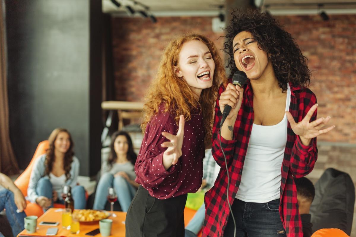 Women singing karaoke