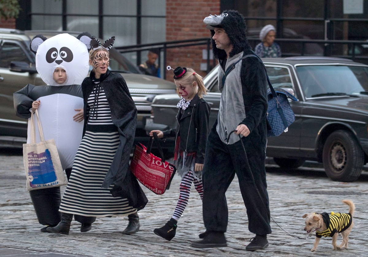 Naomi Watts, Liev Schreiber, and kids trick or treating in 2018