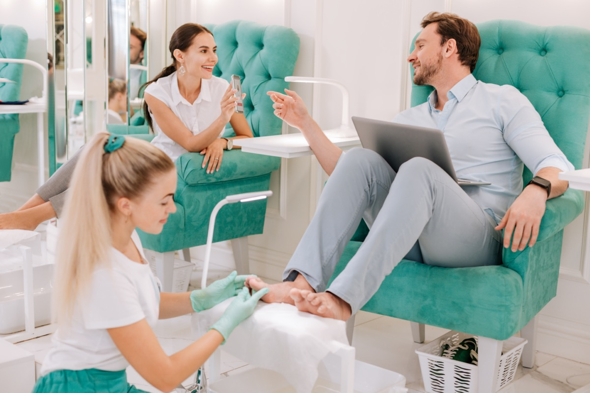 Man and woman getting pedicures