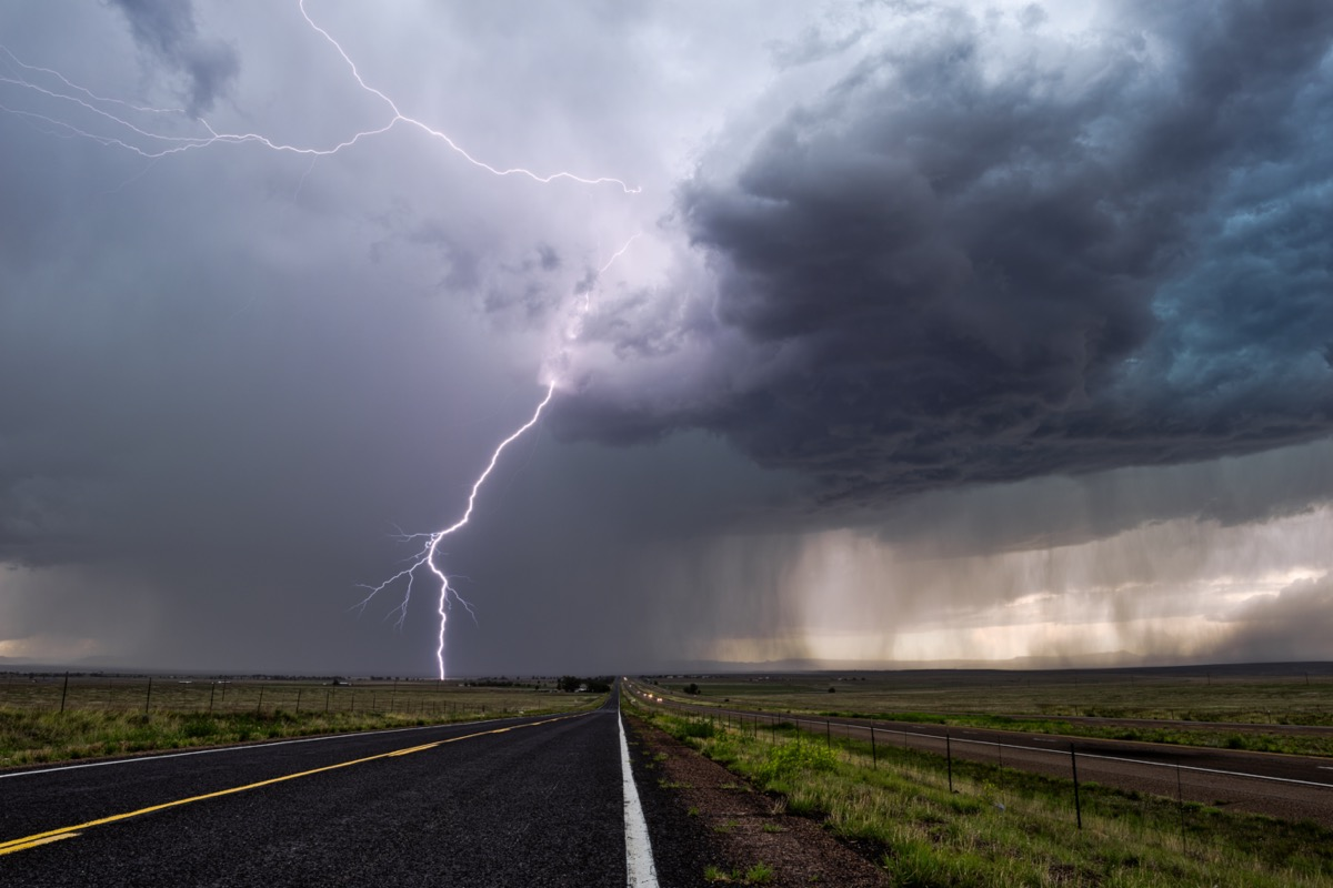 Lightning and thunderstorm over highway