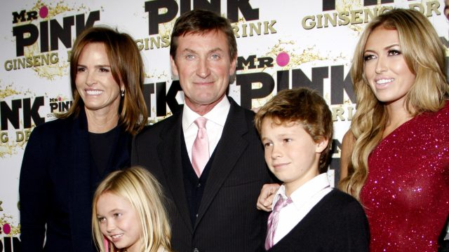 Wayne Gretzky, Janet Jones, and three of their children at the launch party for Mr. Pink Ginseng Drink in 2012