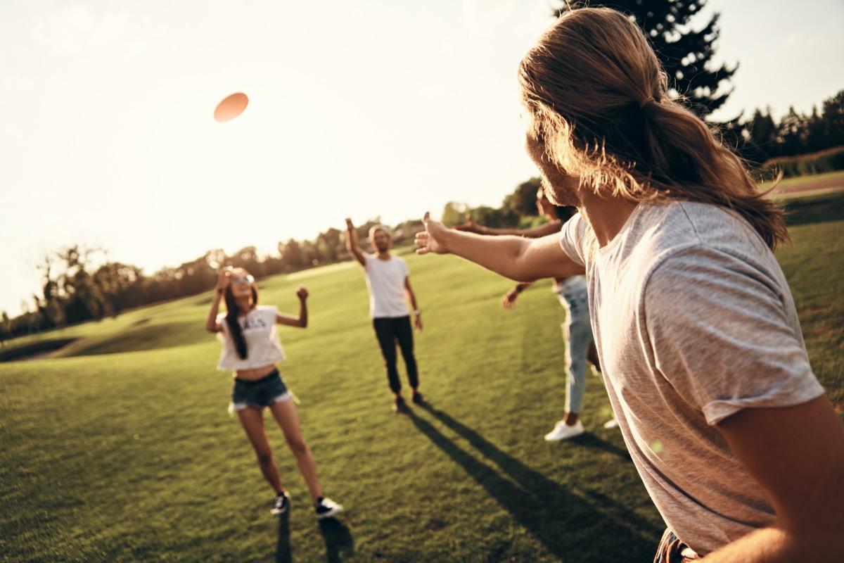 Women playing frisbee