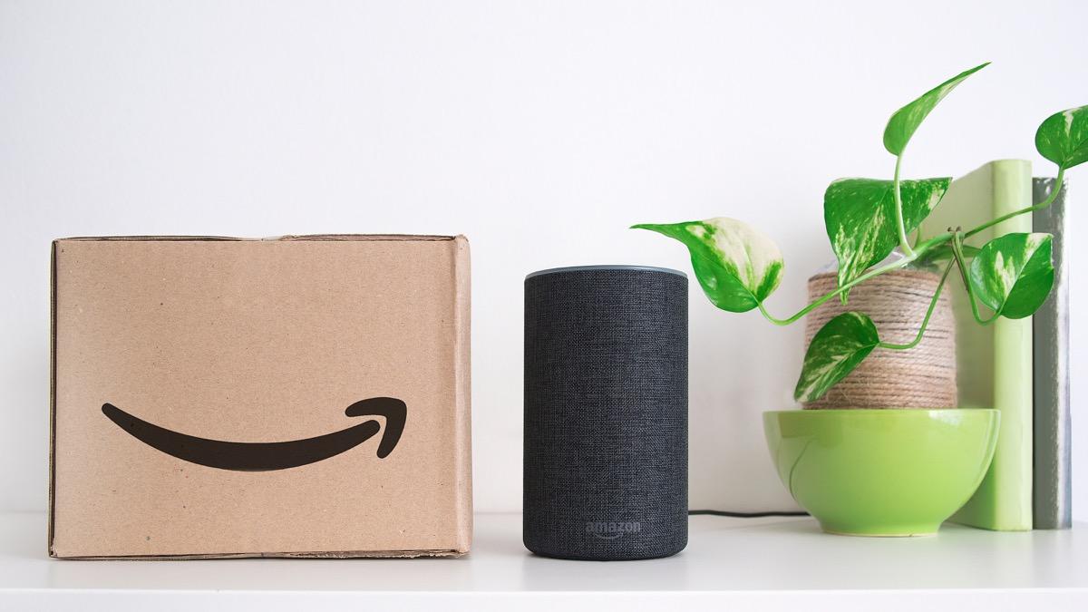 BARCELONA - SEPTEMBER 2018: Amazon Echo Smart Home Alexa Voice Service next to an order in a cardboard box in a living room on September 25, 2018 in Barcelona.