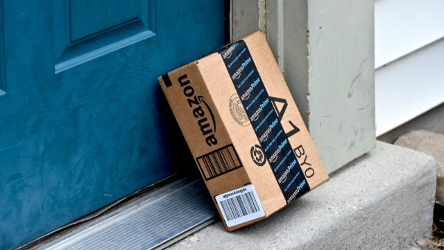 amazon box outside blue residential door