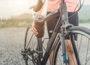 man on bike holding water bottle