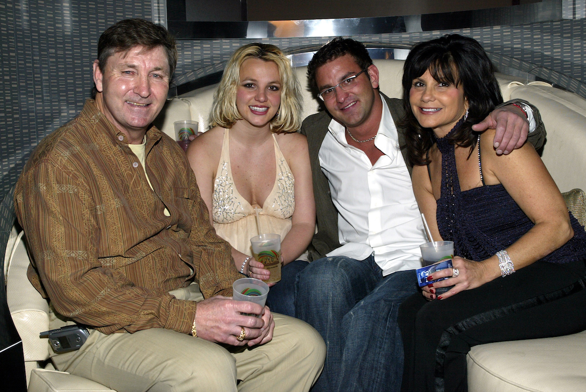 Singer Britney Spears (2nd,L) and family (L-R), father Jamie, brother Bryan and mother Lynne celebrate with Jamie Spears's partners (not shown) George and Phil Maloof and John Decastro, at the launch party for their new Palms Home Poker Host software held at the one of a kind Hardwood Suite at the Palms Casino Resort in Las Vegas.