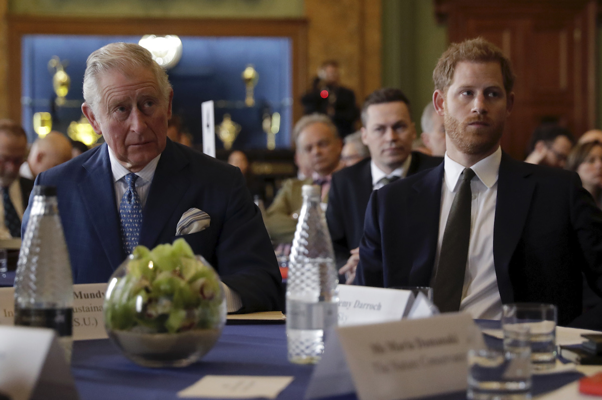 Prince Harry and Prince Charles, Prince of Wales attend the 'International Year of The Reef' 2018 meeting at Fishmongers Hall on February 14, 2018 in London.