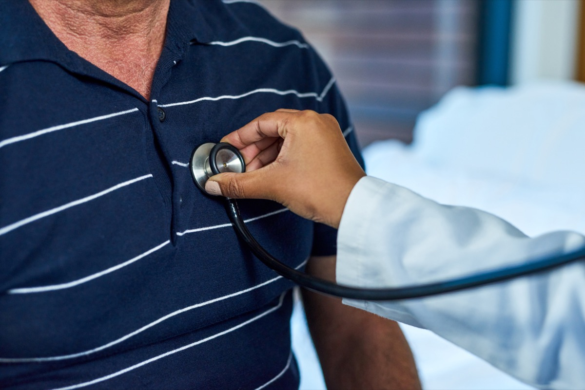 Closeup shot of a doctor examining a patient with a stethoscope