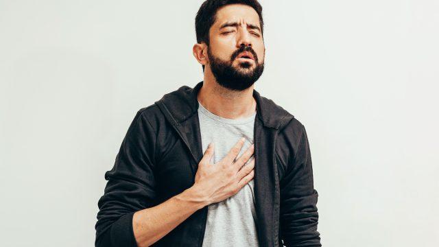 Sick man with shortness of breath symptom