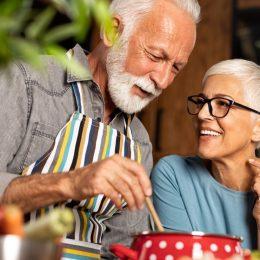 Older couple cooking together