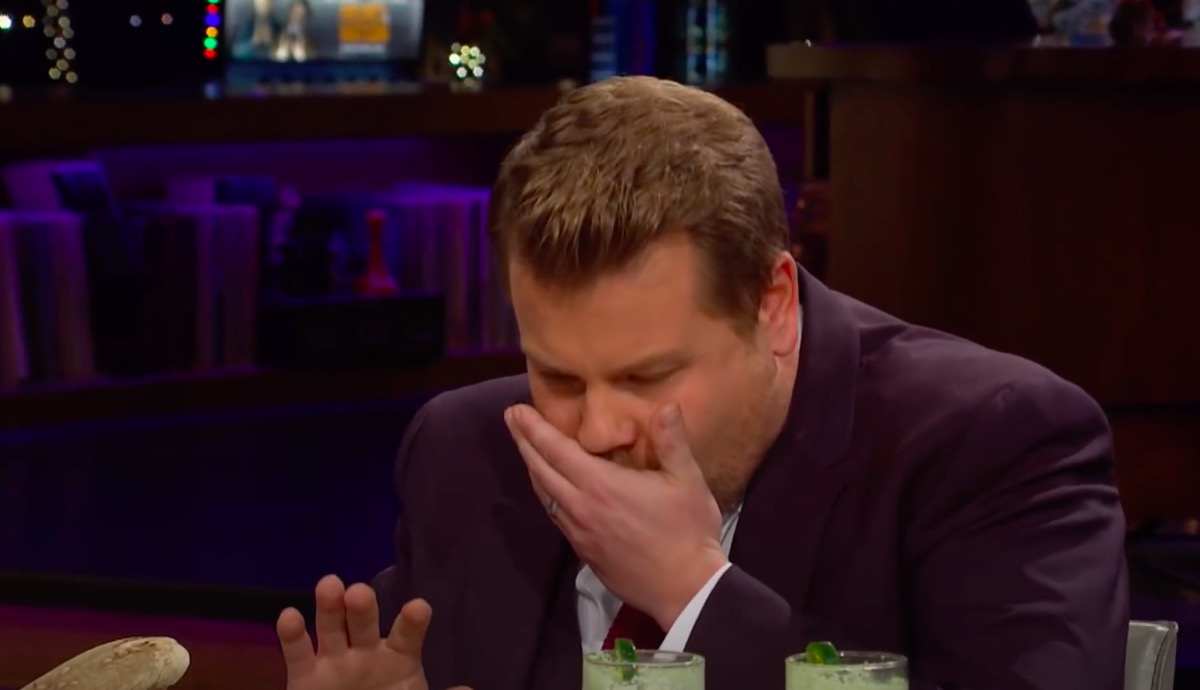 James corden about to spit out food on Spill Your Guts