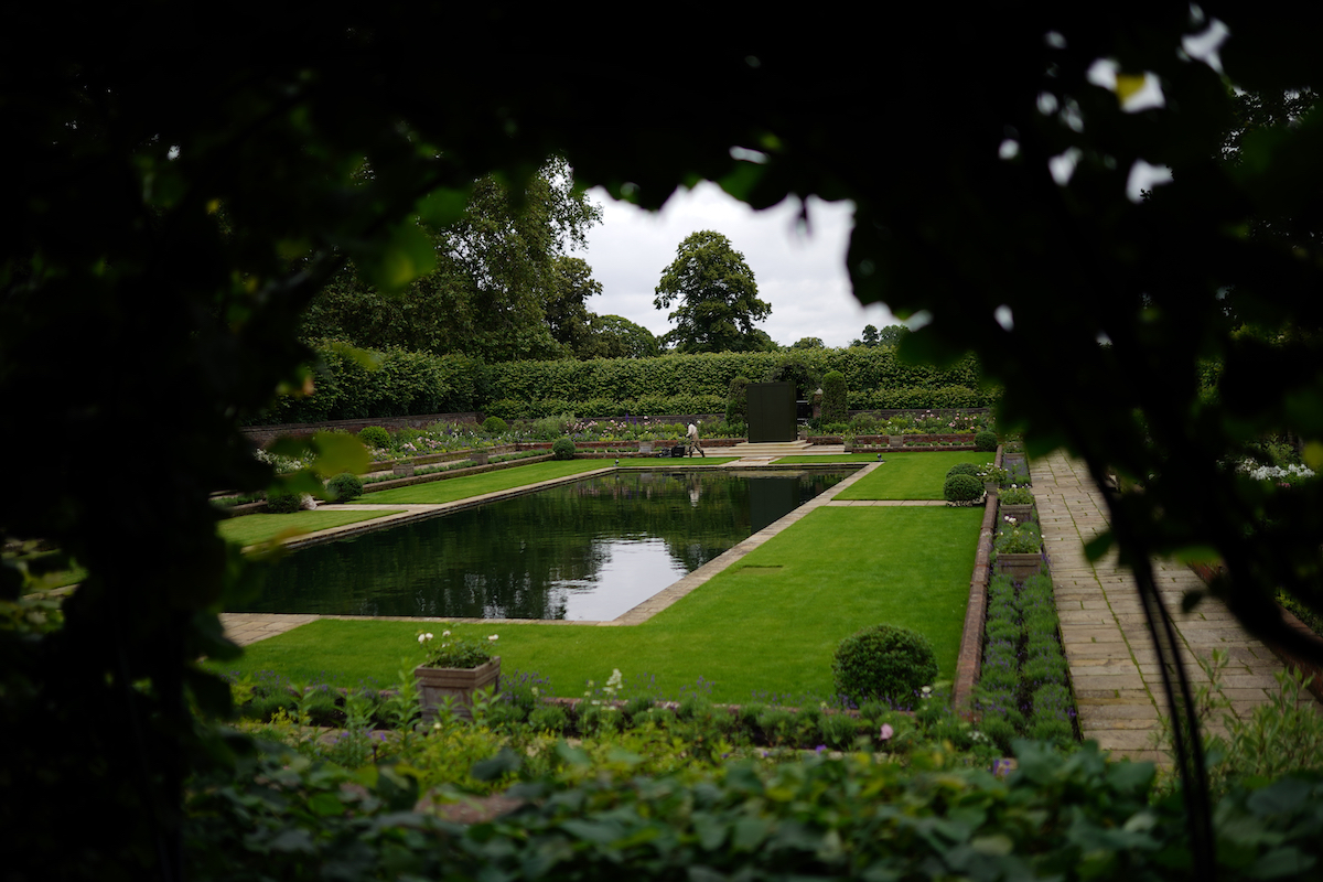 A gardener works in the Sunken Garden at Kensington Palace, London, the former home of Diana, Princess of Wales, where her sons, the Duke of Cambridge and the Duke of Sussex, will put their differences aside when they unveil a statue in her memory on what would have been her 60th birthday.
