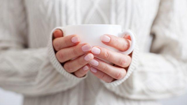 Person holding a mug