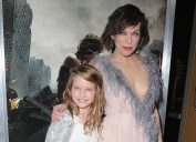 """Milla Jovovich and daughter Ever Anderson arrive at the Los Angeles premiere """"Resident Evil: The Final Chapter"""" at Regal LA Live: A Barco Innovation Center on January 23, 2017 in Los Angeles, California"""