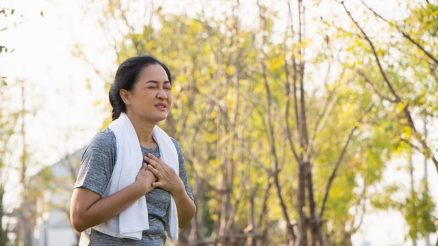 suffer from exercise pain. Senior woman having heart attack