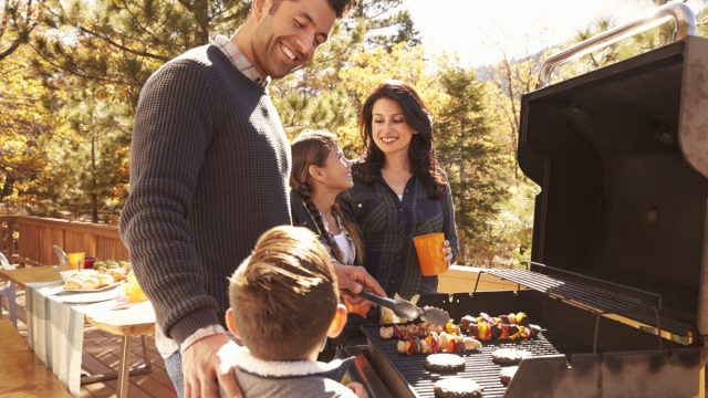 young family having barbecue