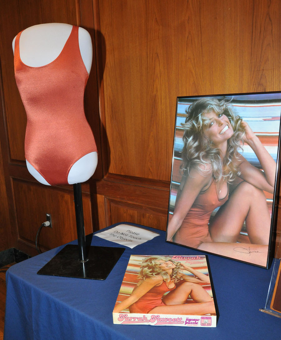 Farrah Fawcett's swimsuit, poster, and a puzzle of the photograph in the National Museum of American History in 2011