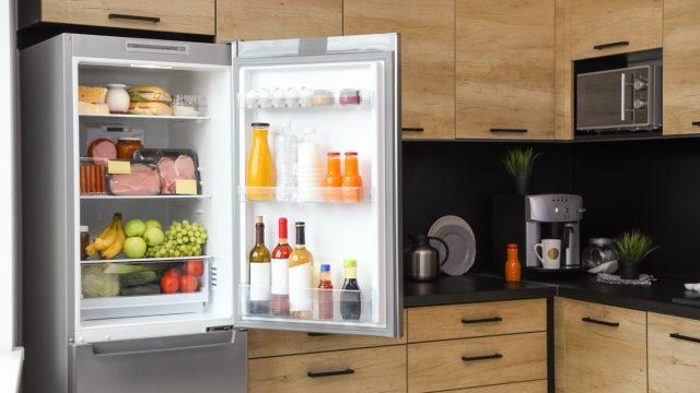 open fridge with drinks in the door