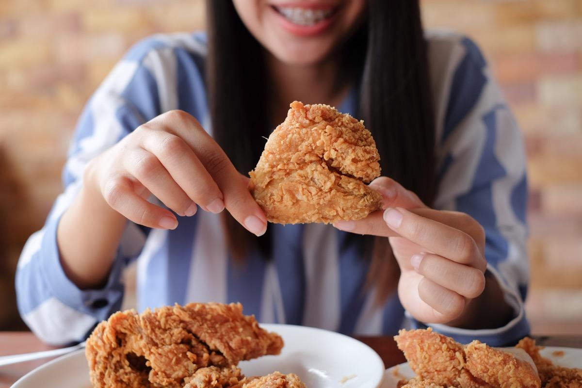 girl eating fried food
